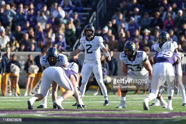 West Virginia Mountaineers quarterback Jarret Doege surveys the defense before the snap in the second quarter of a Big 12 football game between the...