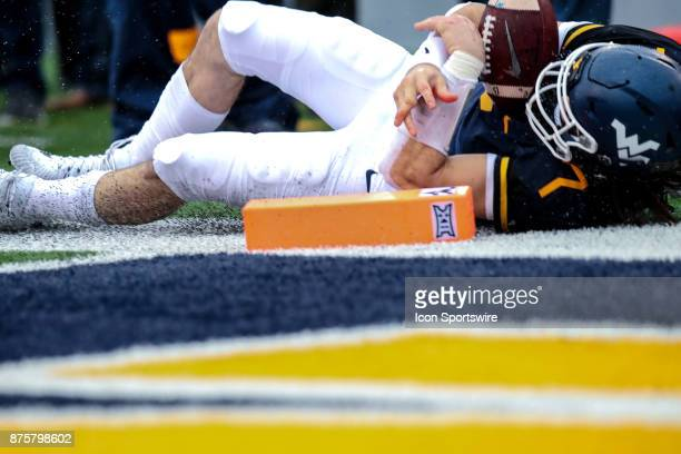 West Virginia Mountaineers quarterback Will Grier dislocates the middle finger on his throwing hand as he dives for the end zone during the first...