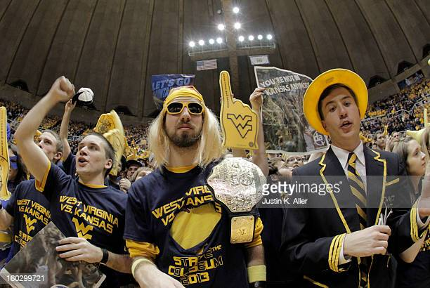 West Virginia Mountaineers students cheer during the game against the Kansas Jayhawks at the WVU Coliseum on January 28 2013 in Morgantown West...