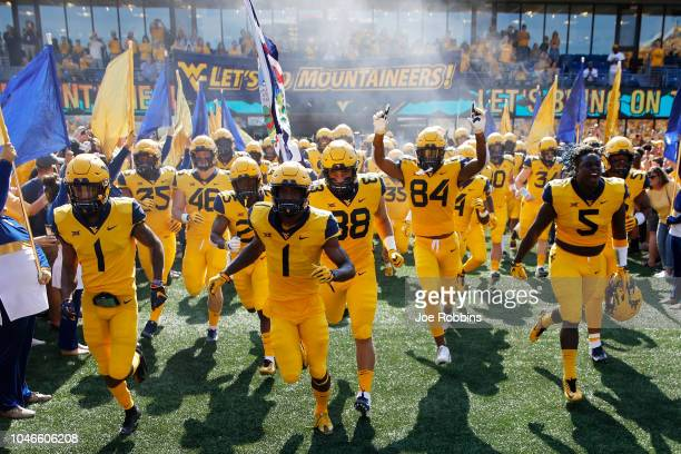 West Virginia Mountaineers take the field before the game against the Kansas Jayhawks at Mountaineer Field on October 6 2018 in Morgantown West...