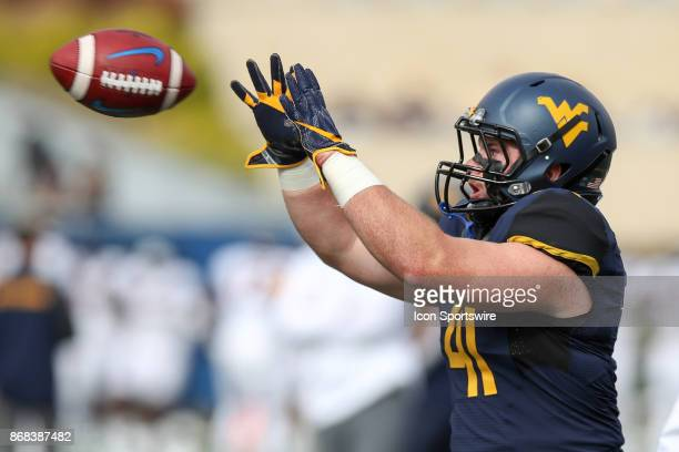 West Virginia Mountaineers tight end/fullback Elijah Drummond catches a pass in warmups prior to the college football game between the Oklahoma State...