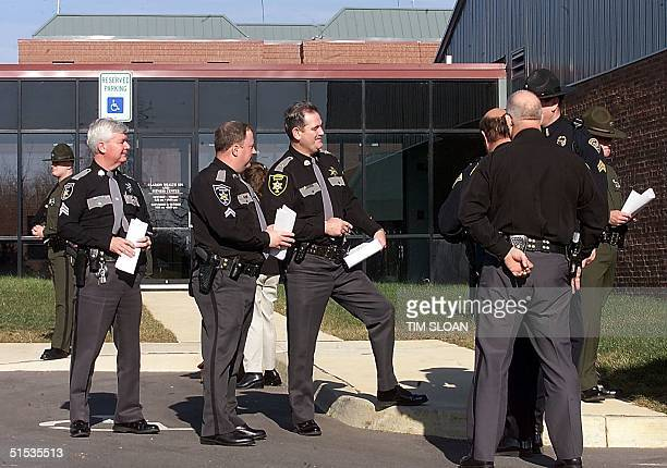 West Virginia State and local police wait to be briefed 02 January 2000 by the US Secret Service outside the Clarion Hotel in Shepherdstown where...