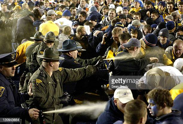West Virginia students and fans are directly hit with pepper spray from West Virginia State Police and WVU Campus Police following the upset win of...