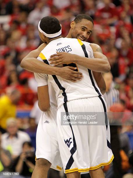 West Virginia's Da'Sean Butler hugs Jonnie West after the Mountaineers defeated Butler 6956 during the men's NCAA Basketball Tournament in Syracuse...