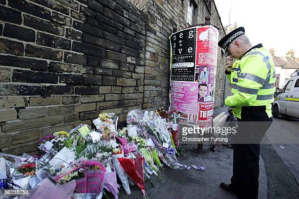 West Yorkshire Police Chief Constable Colin Cramphorn looks at flowers left in tribute for murdered colleague Constable Sharon Beshenivsky at the...