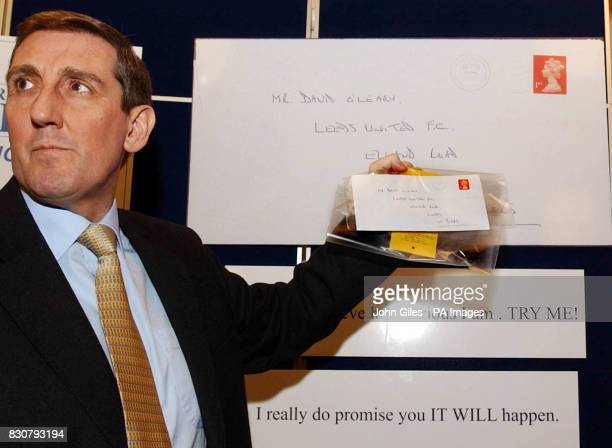 West Yorkshire Police's Detective Superintendent Eddie Hemsley holds an envelope containing one of the threatening letters to Leeds United Manager...