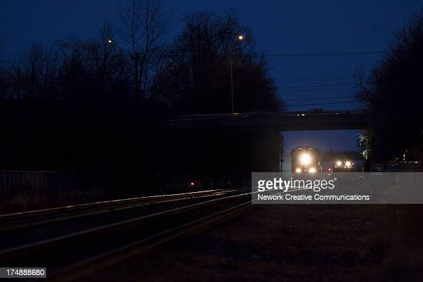 CONTENT] Westbound CN freight train led by a SD70I locomotive passes a work gang installing track switches between Mountainview Road and Maple Avenue...