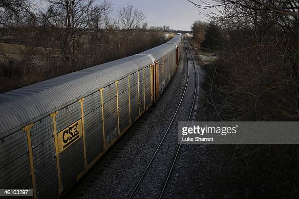 A westbound Norfolk Southern Corp freight train passes along tracks January 6 2014 in Waddy Kentucky Intermodal rail traffic in the United States...