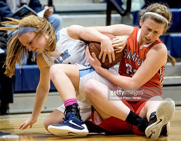 Westbrook's Julia Martel and Sanford's Morgan Coleman fight for a loose ball on the floor during a girls basketball game Tuesday January 26 2016