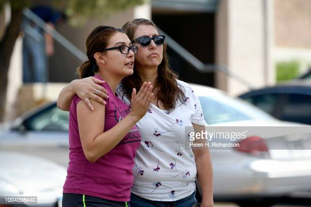 Westbury Apartment resident Stefanie Rodriquez left describes to her mother Dina Delgado what the fire was like the night before at the scene of a...