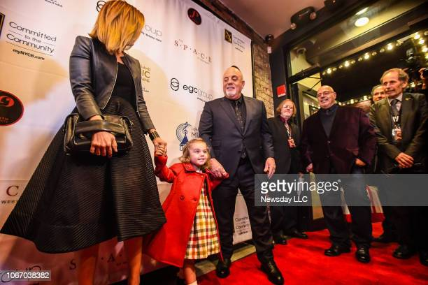 Billy Joel with his wife Alexis Roderick and daughter Della Rose on the red carpet during the Long Island Music Hall of Fame Gala at the Space at...