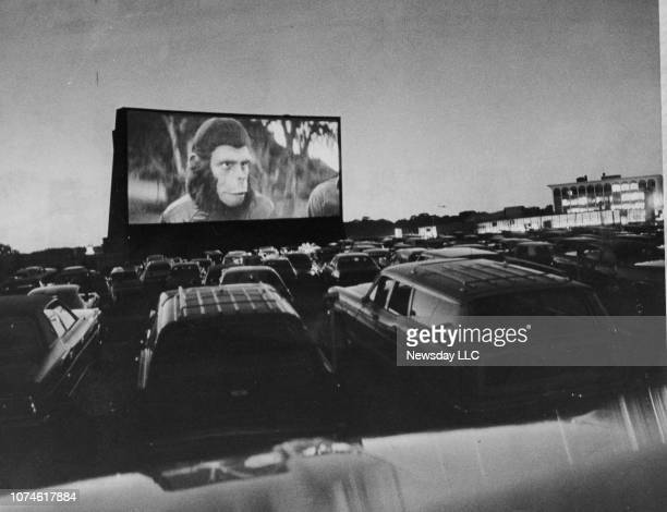 Customers at the Westbury DriveIn Theatre attend an Ape AThon which featured five of the Planet of the Apes movies on July 12 1973 in Westbury New...