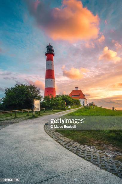westerhever lighthouse at sunset, germany. - nordsee stock-fotos und bilder