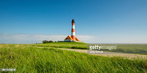 westerhever lighthouse - schleswig holstein stock photos and pictures