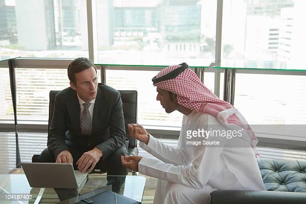 Western and middle eastern businessmen having meeting