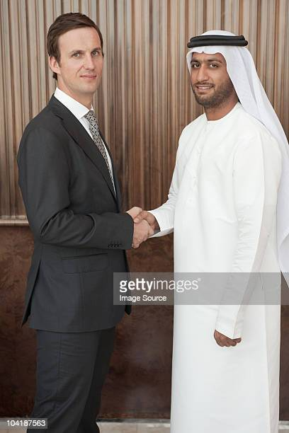 Western and middle eastern businessmen shaking hands