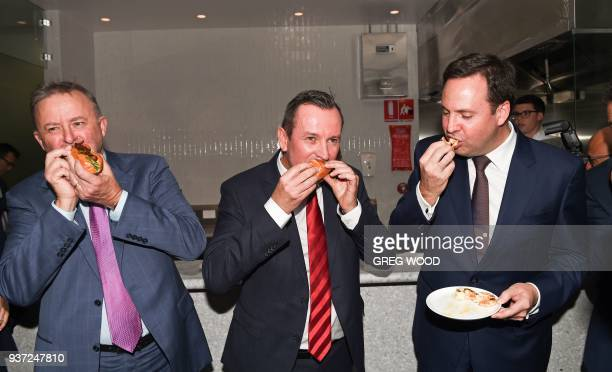 Western Australia Premier Mark McGowan and politicians Anthony Albanese and Steven Ciobo eat food during the opening of the new transit lounge at...