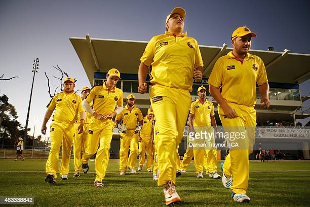 Western Australia run onto the ground for the Semi Final against New South Wales during the 20415 Imparja Cup on February 13 2015 in Alice Springs...