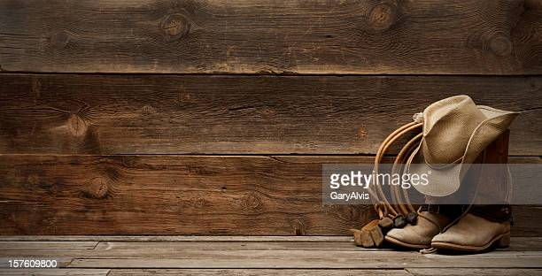 western barnwood background w/boots,hat,lasso-extra wide - lasso stockfoto's en -beelden
