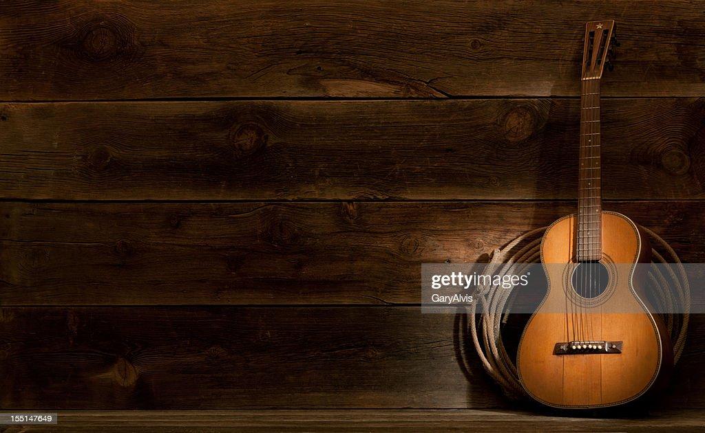 Western barnwood background w/parlor guitar & lasso : Stock Photo