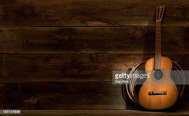 western barnwood background w/parlor guitar & lasso - countrymusik bildbanksfoton och bilder