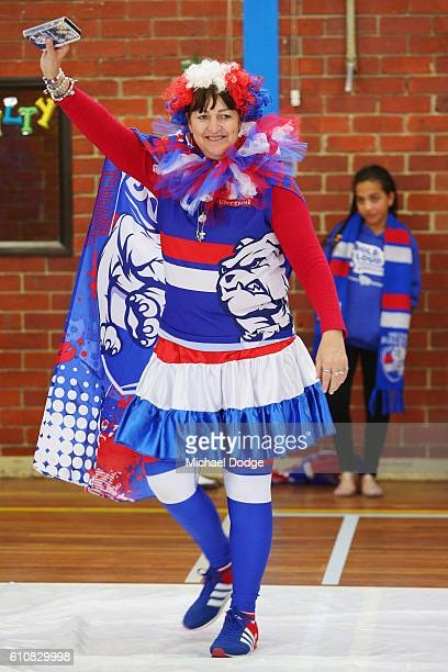 Western Bulldogs cheer squad member arrives to begin to make the AFL Grand Final banner at Whitten Oval on September 28 2016 in Melbourne Australia