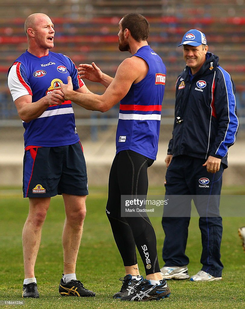 Western Bulldogs coach Rodney Eade (R) laughs at Barry Hall and Ben Hudson during a Western Bulldogs AFL training session at Whitten Oval on June 16, 2011 in Melbourne, Australia.