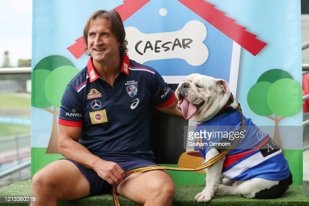 Western Bulldogs head coach Luke Beveridge poses with club mascot Caesar during a Western Bulldogs AFL media opportunity at Whitten Oval on March 19,...