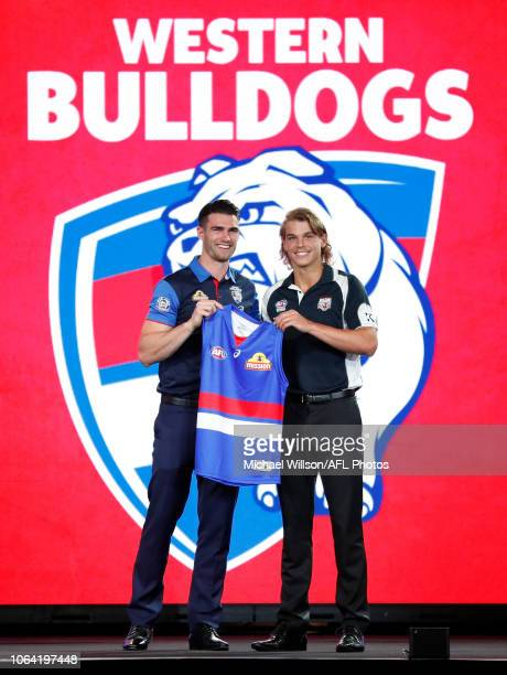 Western Bulldogs' number 7 pick Bailey Smith poses with new teammate Easton Wood during the 2018 NAB AFL Draft at Marvel Stadium on November 22 2018...