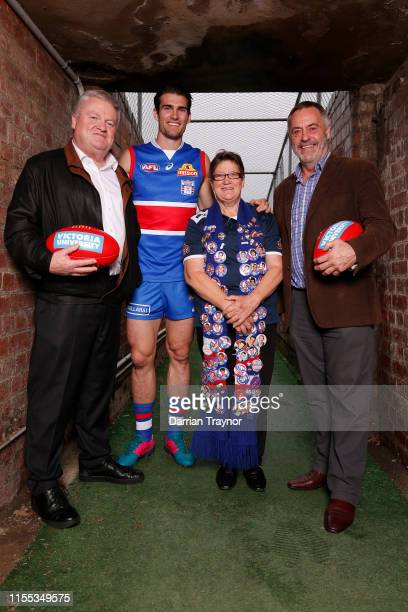 Western Bulldogs president Peter Gordon, Captain Easton Wood, fan Irene Chatfield and former coach Terry Wheeler pose for a photo during a Western...