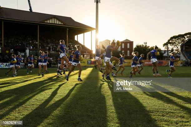 Western Bulldogs run out for their warm up during the 2019 NAB AFLW Round 01 match between the Adelaide Crows and the Western Bulldogs at Norwood...