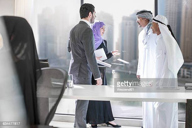 western businessman meeting middle eastern businessmen - middle east stock pictures, royalty-free photos & images