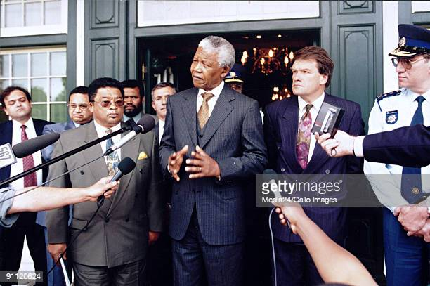 Western Cape Premier Peter Marais and Mark Wiley from the National Party stand beside Nelson Mandela after discussions about violence in the Western...