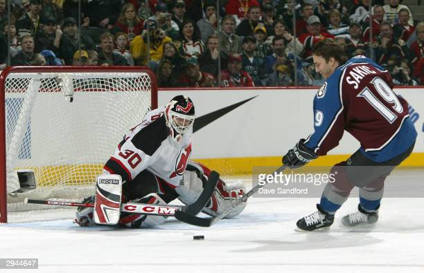 Western Conference All Star Joe Sakic of the Colorado Avalanche challenges Martin Brodeur of the New Jersey Devils at the NHL AllStar Super Skills...