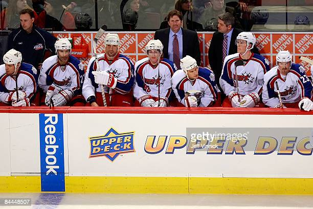 Western Conference AllStar coaches Mike Babcock of the Detroit Red Wings and Todd McLellan of the San Jose Sharks stand behind their players on the...