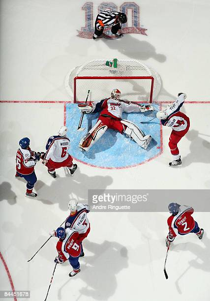 Western Conference AllStar goalie Niklas Backstrom of the Minnesota Wild sprawls out on the ice to make a save attempt against the Eastern Conference...