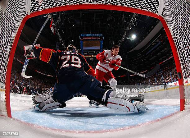 Western Conference AllStar Pavel Datsyuk of the Detroit Red Wings scores a goal on goaltender Tomas Vokoun of the Florida Panthers during the...