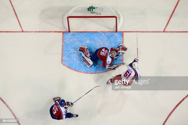 Western Conference AllStar Rick Nash of the Columbus Blue Jackets scores a second period goal against Eastern Conference AllStar goalie Henrik...