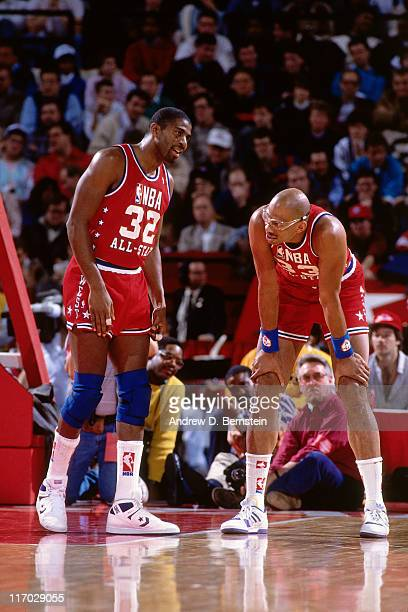 Western Conference allstars Earvin Magic Johnson and Kareem AbdulJabbar talk during a break in the action during the 1988 NBA AllStar Game on...