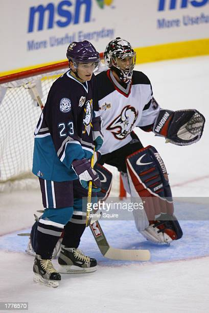 Western Conference forward Stanislav Chistov of the Anaheim Mighty Ducks and Eastern goalie Ryan Miller of the Buffalo Sabres get ready for the...