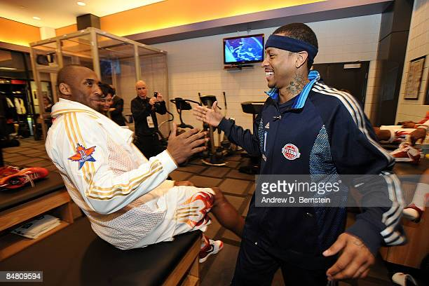 Western Conference Kobe Bryant of the Los Angeles Lakers greets Eastern Conference AllStar Allen Iverson of the Detroit Pistons during the 58th NBA...