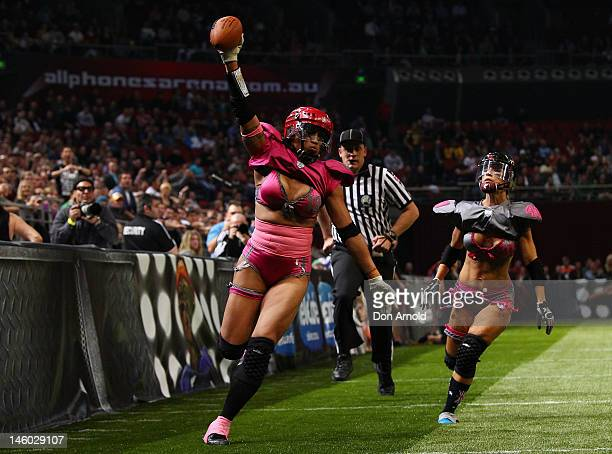 Western Conference player Sunshine UIi runs over for a touchdown during games two of the AllStar Lingerie Football League tour at Allphones Arena on...