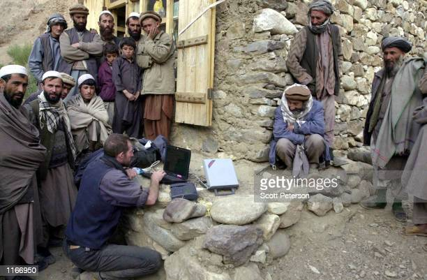 A western correspondent in northern Afghanistan sends a dispatch by satellite phone October 1 2001 from the remote village of Rocha in the Panjshir...