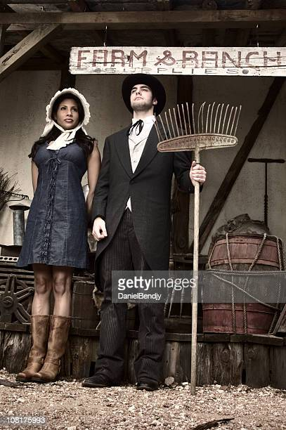 Western Couple Standing at Farm Ranch