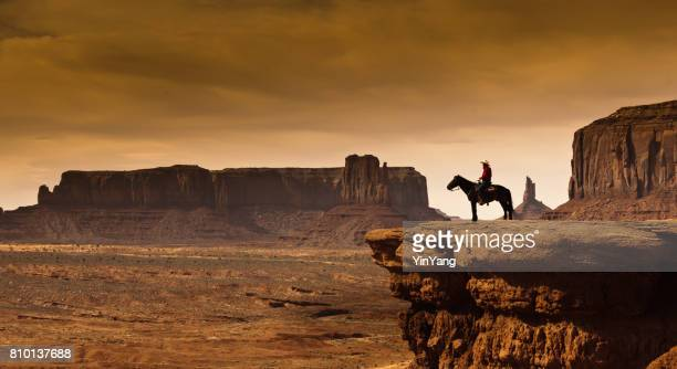 western cowboy native american on horseback at monument valley tribal park - film stock pictures, royalty-free photos & images