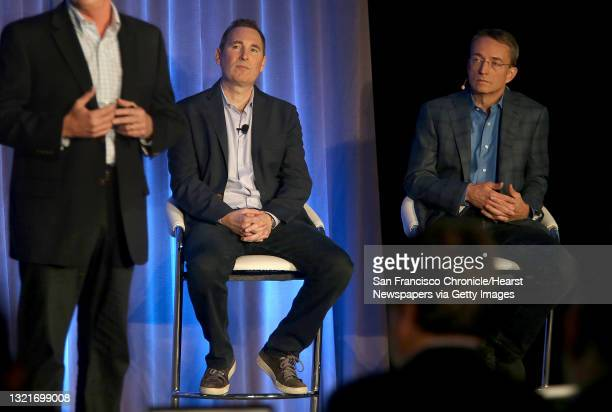 Western Digital CIO Steven Phillpott speaks with CEO Andy Jassy and VMware CEO Parick P. Gelsinger during a press conference announcing Amazon's...