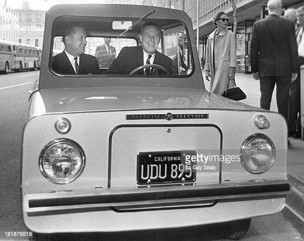 MAY 7 1966 MAY 9 1967 Western Electric Corp's Electric Car Called The Markette J D Howard left Redlands Calif is district sales manager for electric...