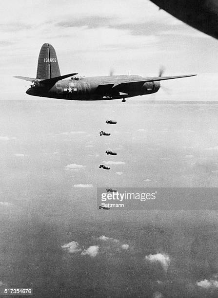 Six 500 pounders neatly spaced as sky steps are starting a quick trip down to Nazi fighter airdrone in Western Europe US Marauders B26 Medium Bombers...