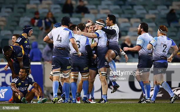 Western Force players celebrate a try during the round 17 Super Rugby match between the Brumbies and the Force at GIO Stadium on July 16 2016 in...