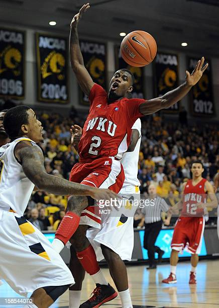 Western Kentucky forward Eddie Alcantara loses the ball against the Virginia Commonwealth University defense in the first half at the Siegel Center...